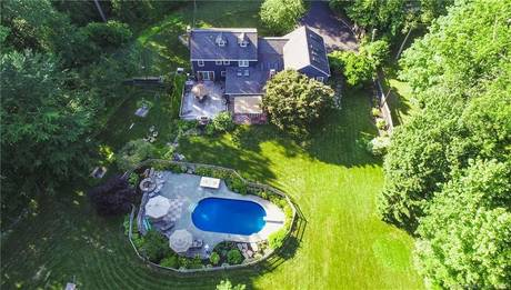 Single Family Home Sold in Fairfield CT 06824. Colonial house near waterfront with swimming pool and 2 car garage.