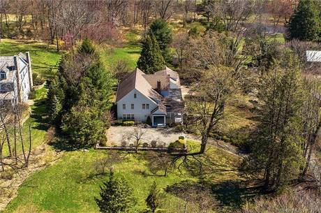 Single Family Home Sold in Wilton CT 06897. Old colonial house near lake side waterfront with 3 car garage.