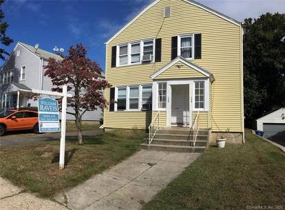 Multi Family Home Sold in Bridgeport CT 06605.  house near waterfront with 2 car garage.