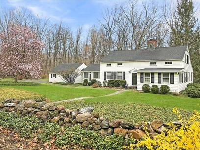 Single Family Home Sold in Wilton CT 06897. Colonial cape cod house near waterfront with 2 car garage.
