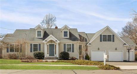 Single Family Home Sold in Fairfield CT 06890.  cape cod house near waterfront with 3 car garage.