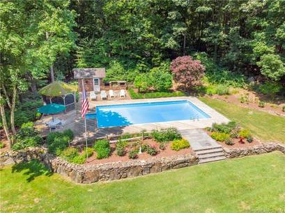 Single Family Home Sold in Redding CT 06896. Ranch house near river side waterfront with swimming pool and 2 car garage.