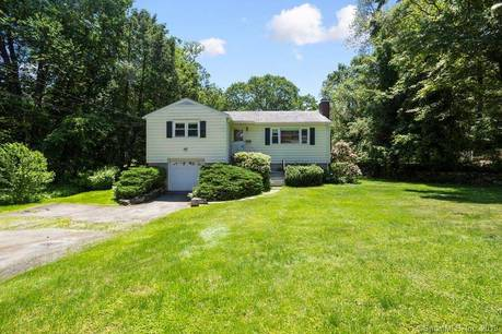 Single Family Home Sold in Greenwich CT 06807. Ranch house near waterfront with 2 car garage.