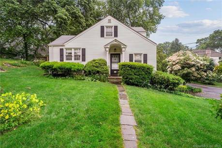 Single Family Home Sold in Greenwich CT 06870.  cape cod house near waterfront with 2 car garage.