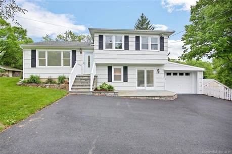 Single Family Home Sold in Norwalk CT 06854.  house near waterfront with 1 car garage.