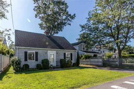 Single Family Home Sold in Norwalk CT 06853.  cape cod house near beach side waterfront with 2 car garage.