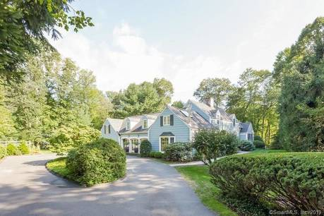 Single Family Home Sold in Darien CT 06820. Old  cape cod house near beach side waterfront with 2 car garage.