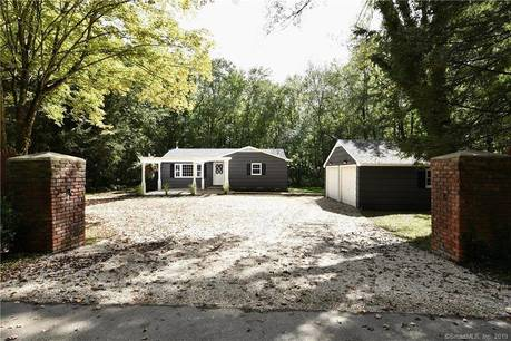 Single Family Home Sold in Redding CT 06896. Ranch bungalow house near waterfront with 2 car garage.