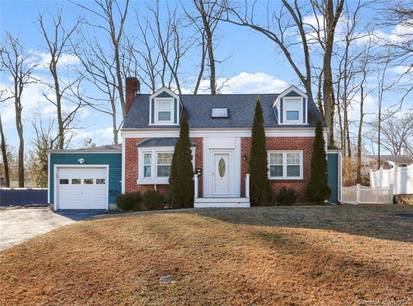Single Family Home For Sale in Stamford CT 06905.  cape cod house near waterfront with 1 car garage.