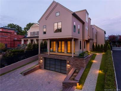 Luxury Condo Home For Sale in Greenwich CT 06830.  townhouse near beach side waterfront with swimming pool and 2 car garage.