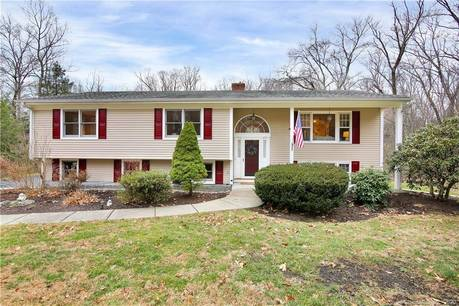 Single Family Home For Sale in Wilton CT 06897. Ranch house near waterfront with 2 car garage.