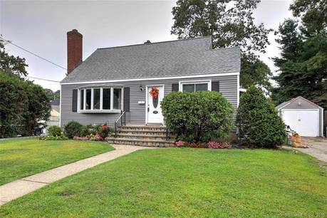 Single Family Home For Sale in Stratford CT 06614.  cape cod house near waterfront with swimming pool and 1 car garage.