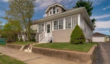 Single Family Home Sold in Bridgeport CT 06604. Old  bungalow house near waterfront with 2 car garage.