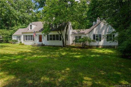 Single Family Home Sold in Stamford CT 06903.  cape cod house near beach side waterfront with 2 car garage.