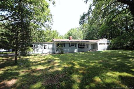 Single Family Home Sold in New Canaan CT 06840. Ranch house near waterfront with swimming pool and 2 car garage.