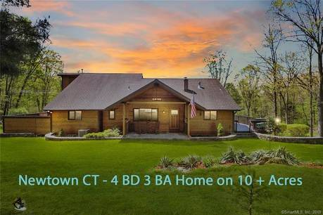 Single Family Home Sold in Newtown CT 06470. Ranch house near lake side waterfront with 3 car garage.
