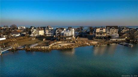 Single Family Home Sold in Fairfield CT 06824. Contemporary house near beach side waterfront with 2 car garage.