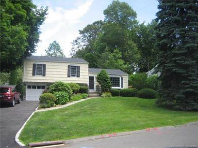 Single Family Home For Sale in Stamford CT 06905.  house near waterfront with 1 car garage.