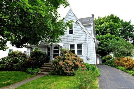 Single Family Home For Sale in Stratford CT 06614. Old colonial house near beach side waterfront with 1 car garage.