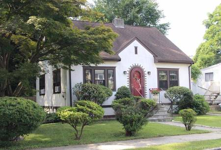 Single Family Home Sold in Stamford CT 06906. Old tudor cape cod house near beach side waterfront with 1 car garage.