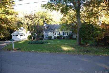 Single Family Home Sold in Darien CT 06820.  cape cod house near river side waterfront with 2 car garage.