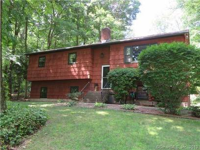 Single Family Home For Sale in Newtown CT 06470. Ranch house near waterfront with swimming pool and 1 car garage.