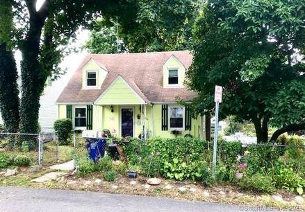Single Family Home For Sale in Norwalk CT 06855.  cape cod house near beach side waterfront with 1 car garage.