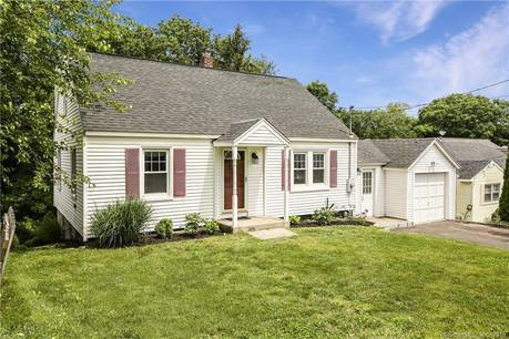 Single Family Home For Sale in Danbury CT 06810.  cape cod house near waterfront with 1 car garage.
