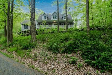 Single Family Home Sold in Sherman CT 06784.  cape cod house near lake side waterfront with 2 car garage.