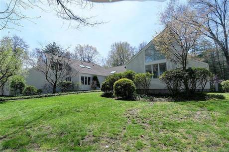 Single Family Home Sold in New Canaan CT 06840. Contemporary house near waterfront with 2 car garage.