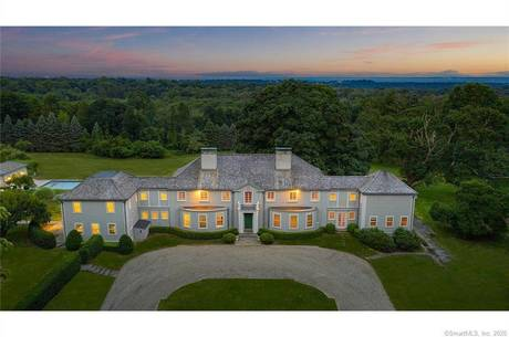 Luxury Mansion Sold in Fairfield CT 06824. Old colonial house near beach side waterfront with swimming pool and 6 car garage.