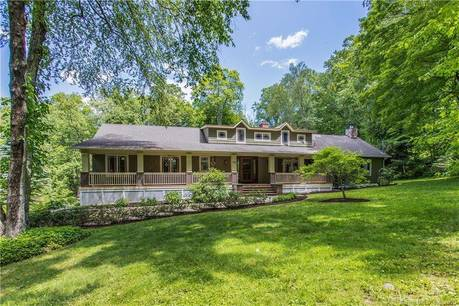 Single Family Home For Sale in Redding CT 06896.  cape cod house near waterfront with swimming pool and 2 car garage.