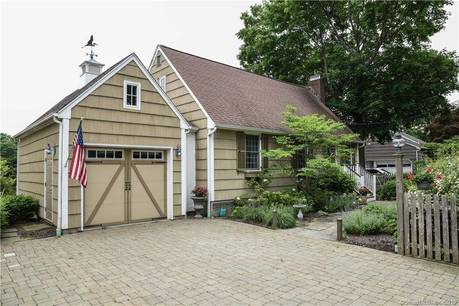 Single Family Home Sold in New Fairfield CT 06812.  cape cod house near beach side waterfront with 1 car garage.