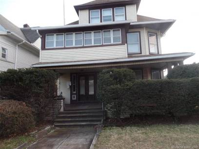 Multi Family Home Sold in Bridgeport CT 06610. Old  house near waterfront with 3 car garage.