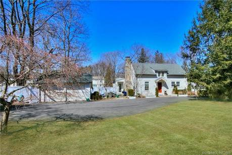 Single Family Home Sold in Westport CT 06880. Old antique cape cod house near river side waterfront with 2 car garage.