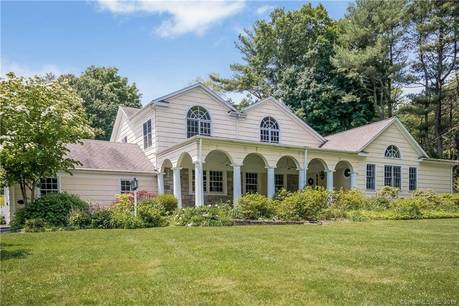 Single Family Home Sold in Fairfield CT 06824. Colonial cape cod house near beach side waterfront with swimming pool and 3 car garage.