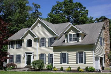 Single Family Home Sold in Ridgefield CT 06877. Colonial house near waterfront with swimming pool and 3 car garage.