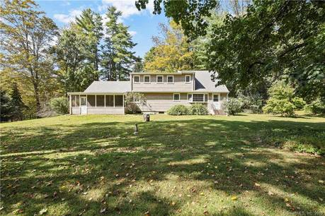 Single Family Home For Sale in Ridgefield CT 06877. Colonial cape cod house near beach side waterfront with 2 car garage.