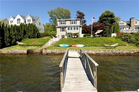 Single Family Home Sold in Brookfield CT 06804.  cape cod house near lake side waterfront with 2 car garage.