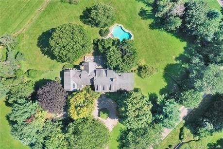 Single Family Home Sold in Fairfield CT 06890.  cape cod house near waterfront with swimming pool and 2 car garage.