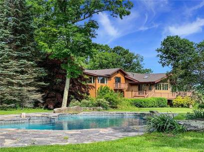 Single Family Home Sold in New Fairfield CT 06812. Contemporary house near waterfront with swimming pool and 2 car garage.