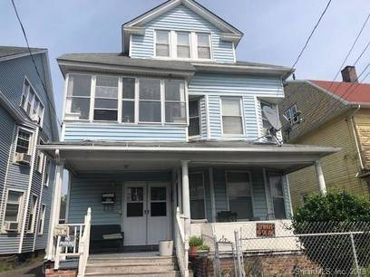 Multi Family Home Sold in Bridgeport CT 06607. Old  house near beach side waterfront with 2 car garage.