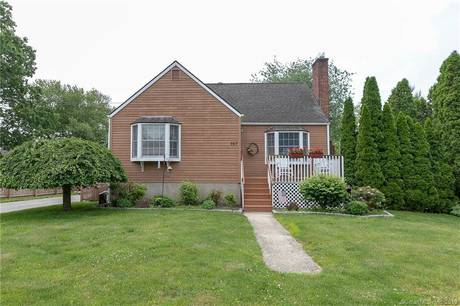 Single Family Home Sold in Stratford CT 06614.  cape cod house near waterfront with swimming pool and 1 car garage.