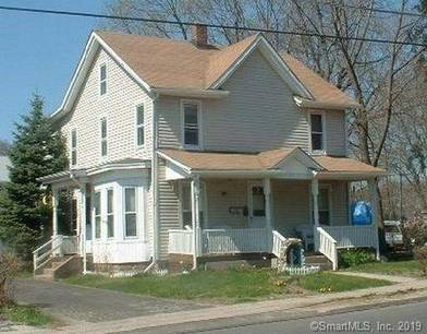 Multi Family Home For Sale in Danbury CT 06810. Old  house near waterfront with 3 car garage.