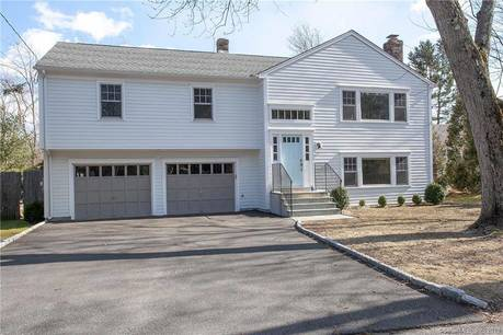 Single Family Home Sold in Westport CT 06880. Ranch house near beach side waterfront with swimming pool and 2 car garage.
