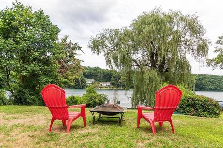 Single Family Home Sold in New Fairfield CT 06812. Ranch bungalow house near lake side waterfront.