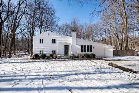 Single Family Home Sold in Westport CT 06880.  house near beach side waterfront with 1 car garage.