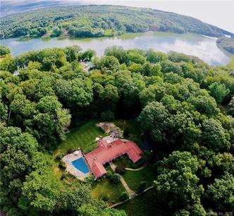 Single Family Home Sold in Brookfield CT 06804. Ranch house near lake side waterfront with swimming pool and 2 car garage.