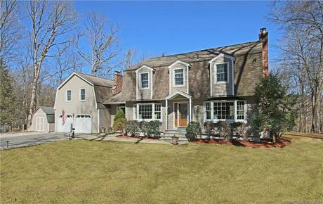 Single Family Home Sold in Redding CT 06896. Colonial house near lake side waterfront with swimming pool and 2 car garage.