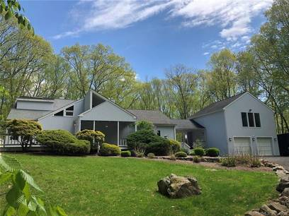 Single Family Home For Sale in Weston CT 06883. Contemporary house near river side waterfront with 2 car garage.
